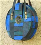 کیف چرم گرد قفل دار ۳