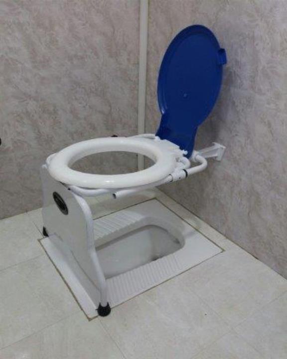 آسانا توالت فرنگی دیواری تاشو روی دیوار
